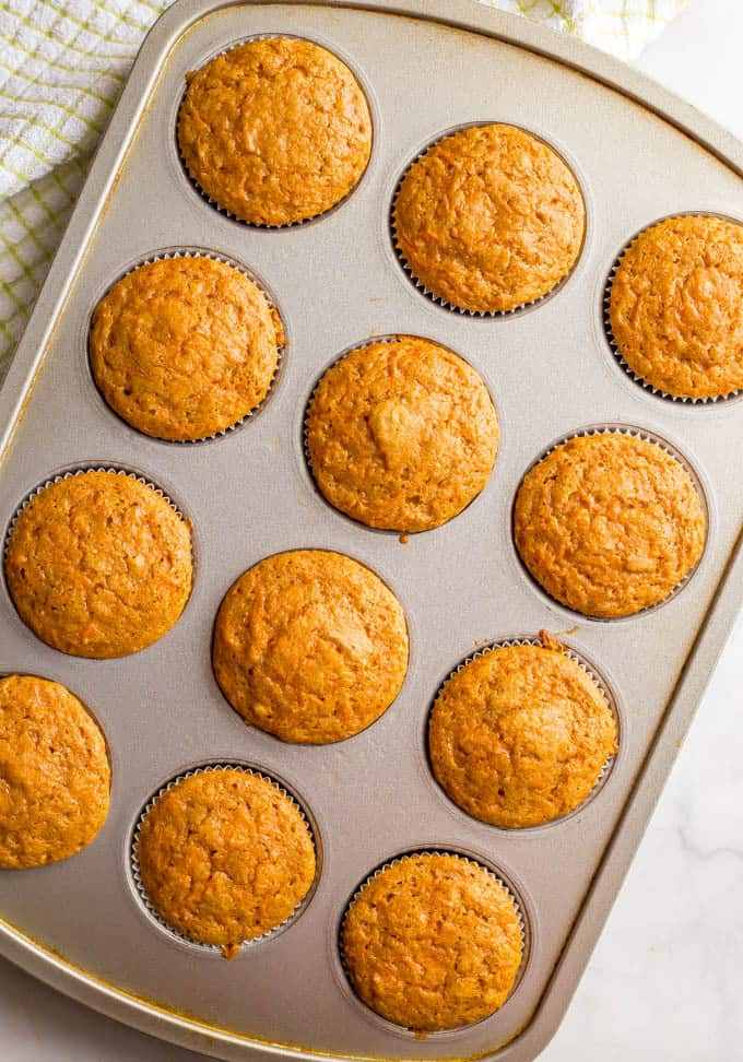Overhead photo of baked whole wheat carrot cake muffins in muffin tin