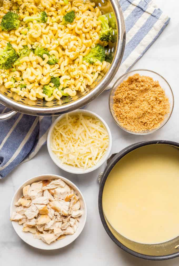 Ingredients for healthy chicken and broccoli mac and cheese laid out on a counter