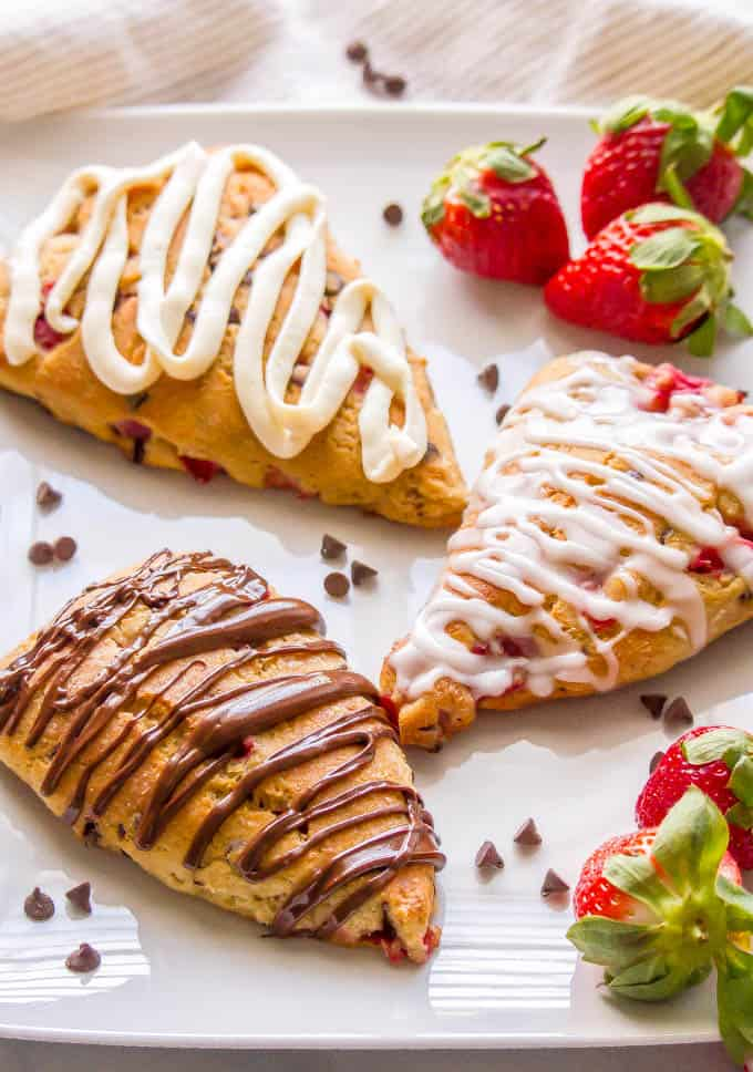 These healthy strawberry scones are whole wheat, naturally sweetened, low in fat and perfect for breakfast or brunch! You can add in some optional mini chocolate chips and/or serve with any of my glaze topping ideas for an extra special treat! #strawberryrecipes #scones #brunchrecipes | www.familyfoodonthetable.com