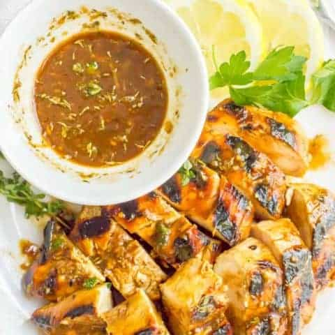 Balsamic herb grilled chicken marinade is tangy, herby and bright and perfect for a quick and easy marinade to give delicious flavor to your grilled rotation.   www.familyfoodonthetable.com