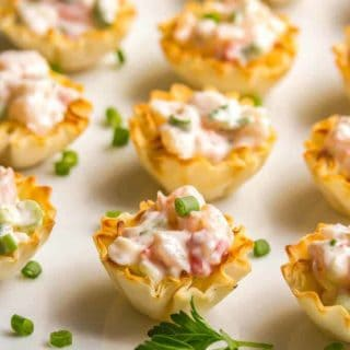 Creamy shrimp salad is perfect for a sophisticated appetizer that's easy to throw together and can be served in phyllo cups or endive leaves, with crackers, or on toast points or baguette slices. | www.familyfoodonthetable.com