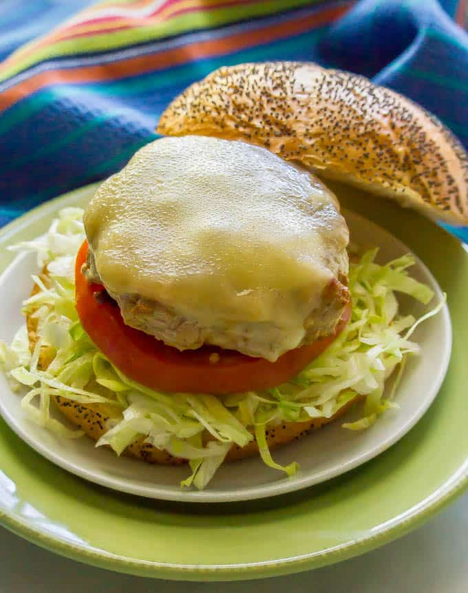 Fiesta turkey burger with melted cheese on a bun with shredded lettuce and tomato
