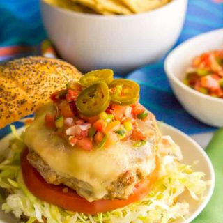 Fiesta turkey burgers have just 4 basic ingredients but create a little flavor explosion in your mouth! Add your favorite taco toppings and dig into these juicy, fun and delicious burgers! | www.familyfoodonthetable.com