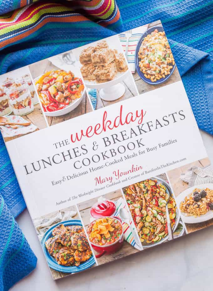 An overhead shot of The Weekday Lunches & Breakfasts Cookbook by Mary Younkin with a colorful blue towel under it