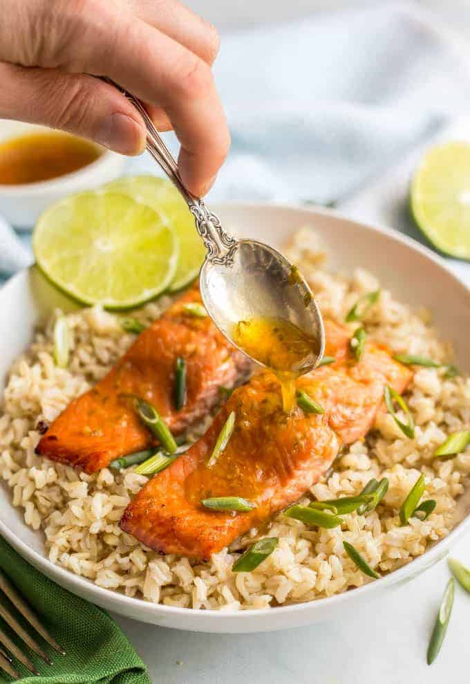 Honey lime salmon is an easy 5-ingredient recipe for a delicious marinated and roasted salmon dinner that's perfectly tender, sweet and tangy! #salmonrecipe #seafooddinner #healthysalmon | www.familyfoodonthetable.com