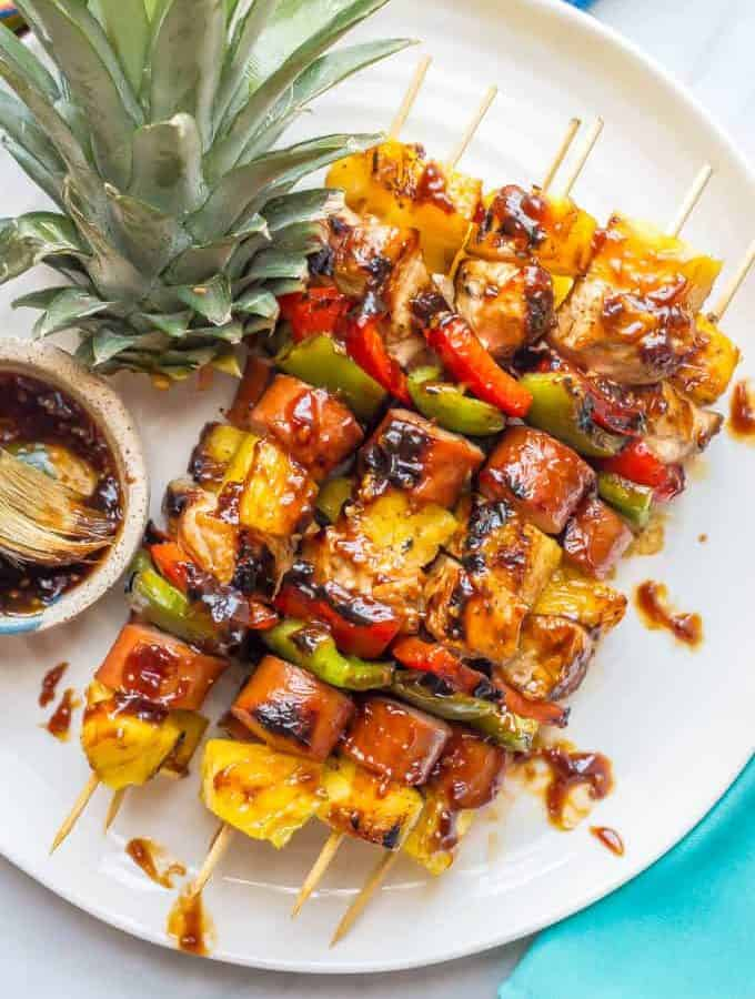 Teriyaki chicken pineapple kabobs are a fun and flavorful recipe for the grill (or oven) with tender chicken, peppers, fresh sweet pineapple and an easy teriyaki sauce that doubles as a marinade and sauce for basting and serving. Perfect for a family dinner or a BBQ party! | www.familyfoodonthetable.com