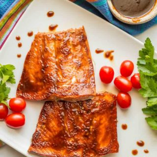 Easy BBQ salmon is a 2-ingredient recipe that can be grilled or oven roasted. It's perfect for a quick weeknight dinner or for meal prepping healthy lunches! #easysalmonrecipe #bbqsalmon #salmondinner #mealprep | www.familyfoodonthetable.com