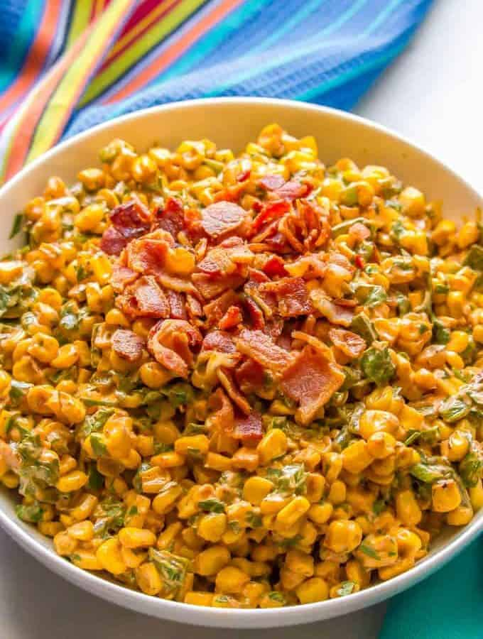 Summer corn salad with roasted poblanos, cilantro and a creamy dressing is a fresh and flavorful veggie side dish. It's great served in individual cups for a portable and fun BBQ recipe everyone will love! #corn #cornsalad #bbqrecipes | www.familyfoodonthetable.com