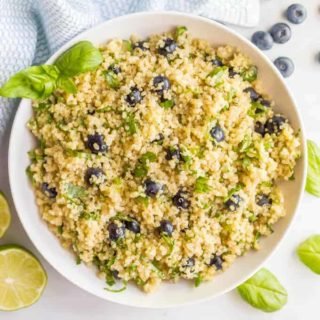 Blueberry basil quinoa salad with honey lime vinaigrette served in a bowl