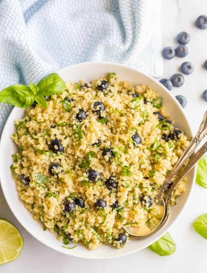Blueberry basil quinoa salad is easy to make and perfect for summer! It's loaded with plump blueberries and fresh herbs and topped with a honey lime vinaigrette for a healthy, delicious side dish! #blueberries #quinoa #quinoasalad #healthysaladrecipe #glutenfree