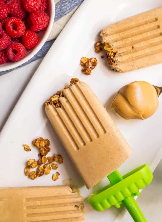 These fun breakfast popsicles are naturally sweetened and made with just 5 healthy ingredients. The creamy peanut butter and banana flavor is addictive and the crushed cereal or granola brings a fun texture! #popsicles #breakfastrecipe #easyrecipe #peanutbutter