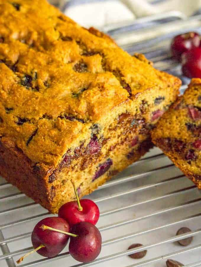 This naturally sweetened and whole wheat cherry chocolate chip bread is perfect for a healthier breakfast or snack and a great way to use fresh cherries in the summer! #cherries #chocolate #quickbread #breakfast #baking