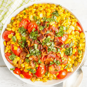 Easy Southern summer succotash features lima beans, corn and tomatoes — plus crumbled bacon — for a delicious classic side dish!