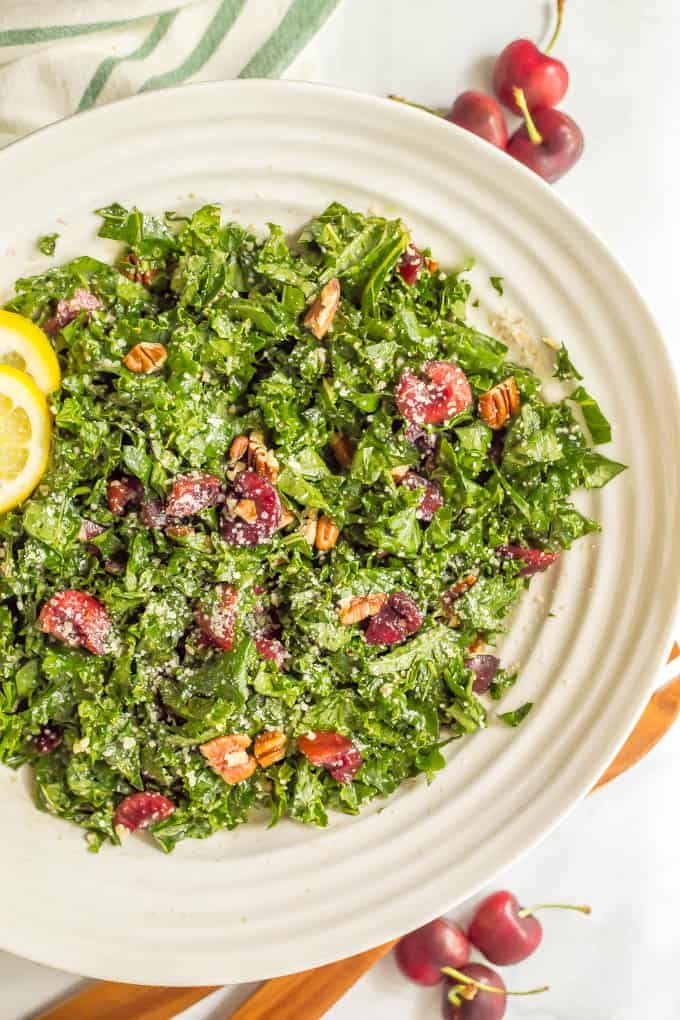 Massaged kale salad with cherries, pecans and Parmesan is perfect for summertime when fresh cherries are in season! It's easy to make and great for dinner, BBQs, picnics and parties! #kalesalad #cherryrecipes #summersalad | www.familyfoodonthetable.com