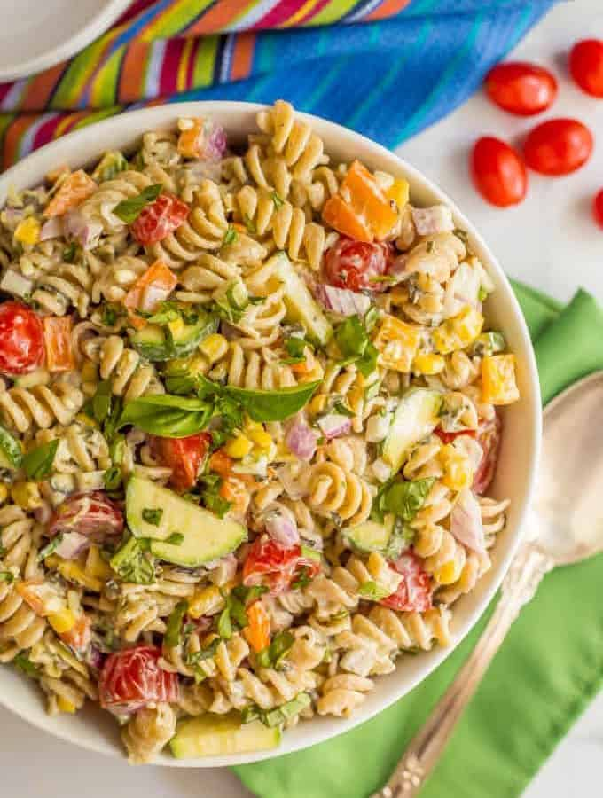 This fresh and colorful summer veggie pasta salad features a creamy 1-ingredient spinach artichoke dressing that coats every bite. It's perfect for BBQ parties, potlucks and picnics all summer long! #summersalad #pastasalad #summerveggies #healthyrecipes | www.familyfoodonthetable.com