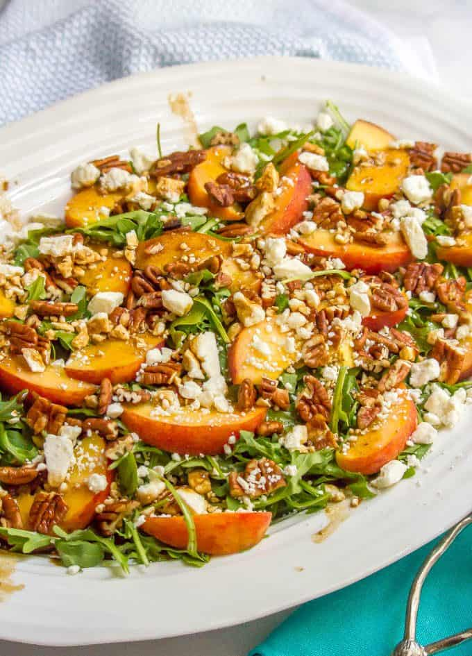 Arugula salad with peaches, pecans and goat cheese with balsamic vinaigrette is perfect for an easy, light and delicious summer side salad! #arugulasalad #peachrecipes #summersalad #saladrecipes #lowcarbrecipes #glutenfreerecipes