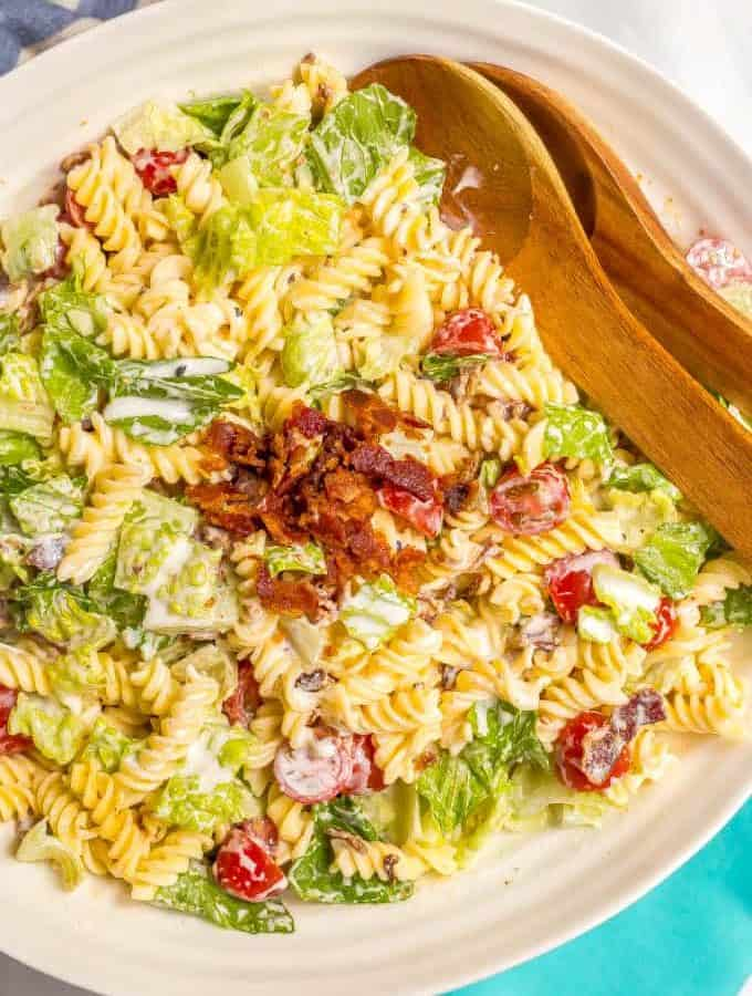 This creamy BLT pasta salad with an easy, homemade dressing is a healthier take on the classic and perfect for summer picnics, cookouts and parties! #pastasalad #BLT #summer #pasta #saladrecipes