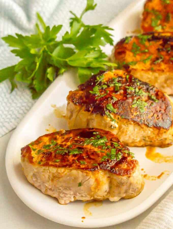 Ranch seasoned pork chops are seared in a skillet and finished in the oven for a quick and easy weeknight dinner that's full of flavor. And they are just 3 ingredients! #porkchops #porkrecipes #Ranch #easyrecipe