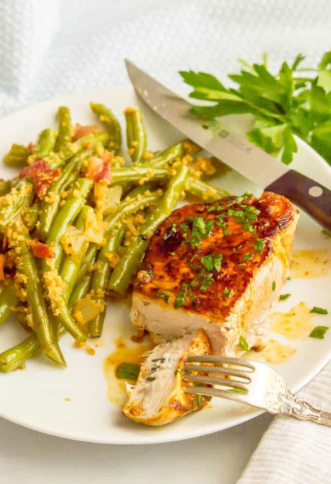 Ranch seasoned pork chop served on a plate with green beans