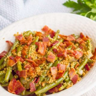 Green beans with bacon and buttery breadcrumbs are just 5 ingredients but packed with so much flavor for a delicious, easy side dish! #greenbeans #sidedish #veggies #veggieside