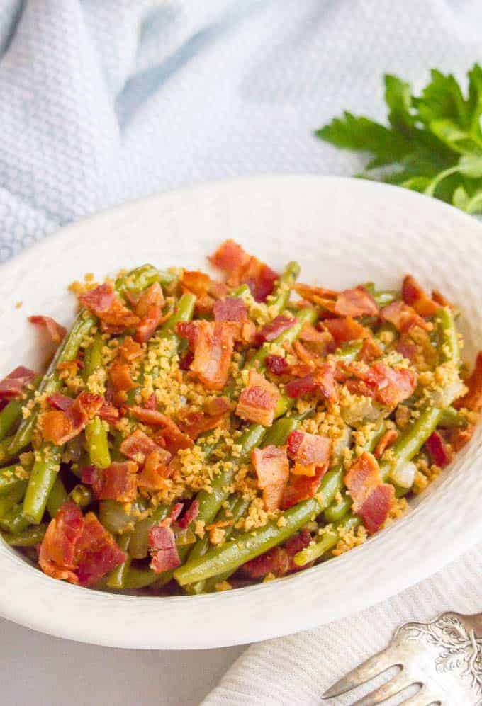 Southern style green beans with bacon and buttery breadcrumbs are just 5 ingredients but packed with so much flavor for a delicious, easy side dish! #greenbeans #sidedish #veggies #veggieside