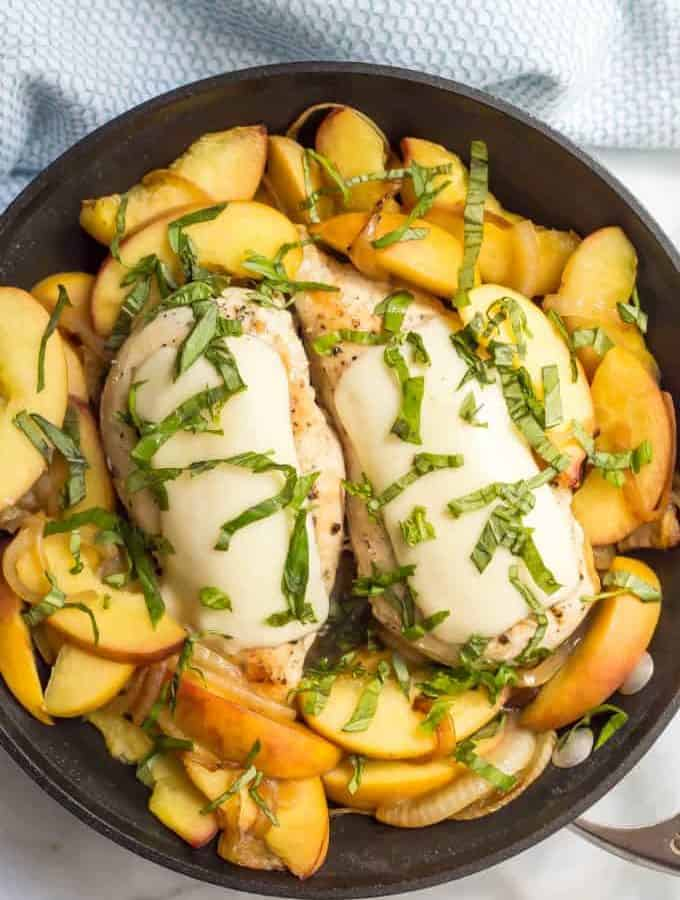 Skillet chicken with peaches is a gorgeous one-pot, 30-minute summer dish with fresh mozzarella and basil for a light, lovely dinner!