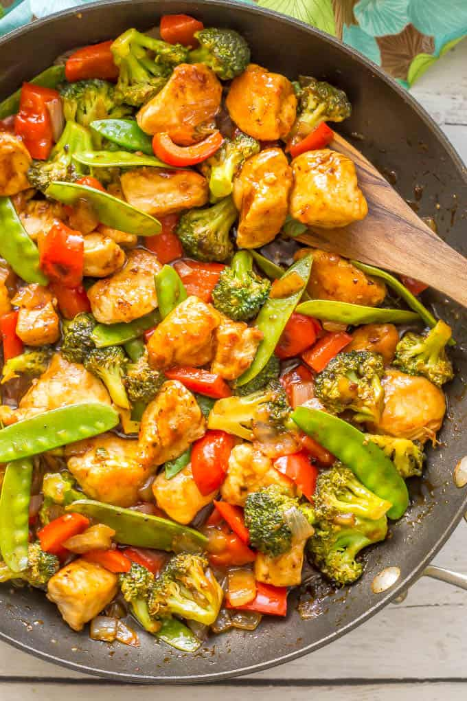 Easy sweet and sour chicken with vegetables is a one-pot meal that's ready in 25 minutes and features a 5-ingredient, 5-minute homemade sweet and sour sauce. It's perfect for a quick and easy weeknight dinner! #chickenrecipes #chickendinner #easydinnerideas