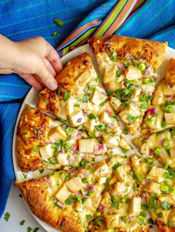 Easy BBQ chicken pizza comes together so quickly with just a few store-bought ingredients and is packed with tons of flavor! It's perfect for a different twist on pizza night! #bbqchicken #pizza #dinner