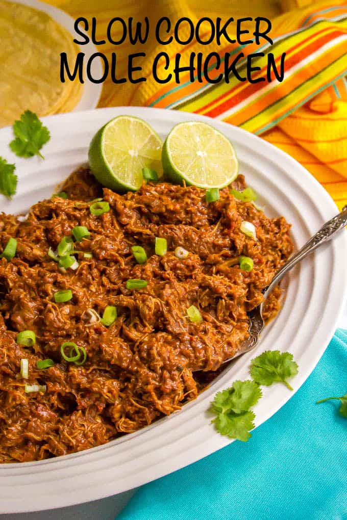 Easy slow cooker mole chicken has such a deep, rich flavor but is made really easy with a blender mole sauce. It's perfect for tacos, rice bowls, wraps, quesadillas and more! #slowcooker #crockpot #chickenrecipe #easyrecipe