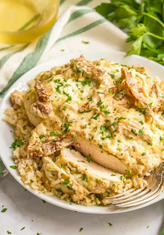 Easy creamy Italian chicken skillet served over brown rice on a white plate