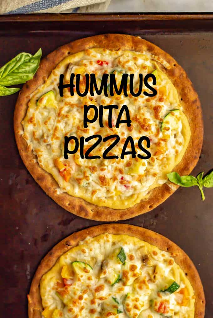Hummus pita pizzas with veggies take just a few minutes to make and are great served warm or cold. Customize with your favorite hummus flavor and veggie toppings and enjoy for lunch, a snack or a light dinner! #hummus #pizza #healthyrecipes
