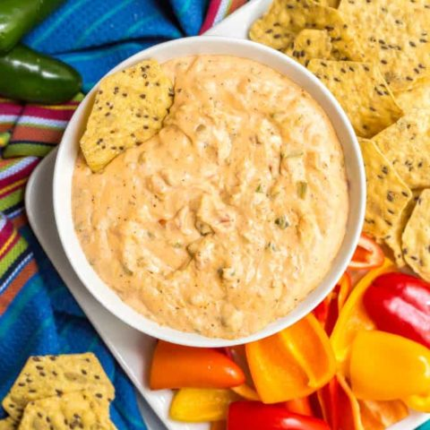 This quick and easy jalapeño cream cheese dip is perfect for parties, served warm with tortilla chips and veggies for dipping. Adjust the spiciness to your liking and get ready to dig in! #jalapenos #jalapenodip #creamcheesedip #appetizers