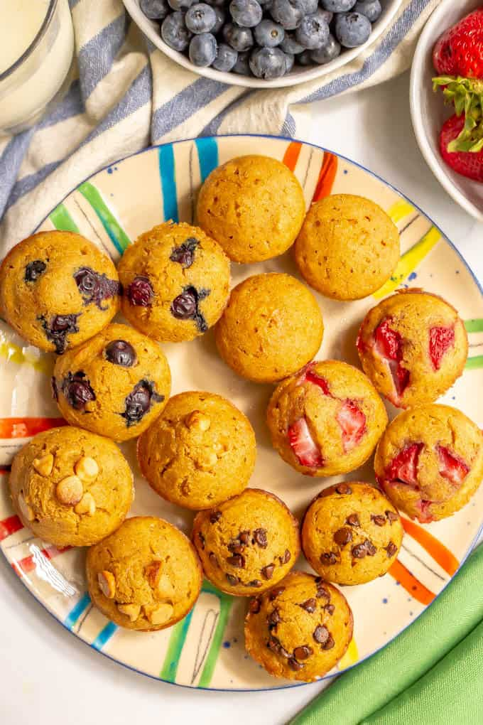 Whole wheat pancake mini muffins with various toppings on a large colorful plate