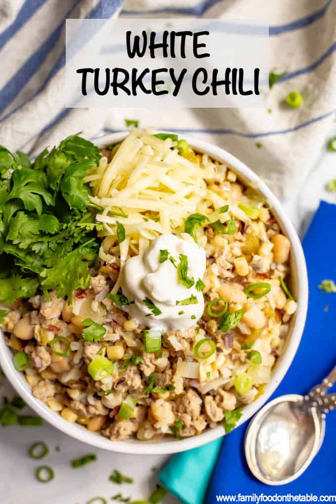 This easy, healthy white turkey chili comes together in about 30 minutes with some simple pantry ingredients. It's full of hearty ground turkey pieces, white beans, rice, corn and green chilies for a hearty meal! #turkeychili #chili #easyrecipe #groundturkey
