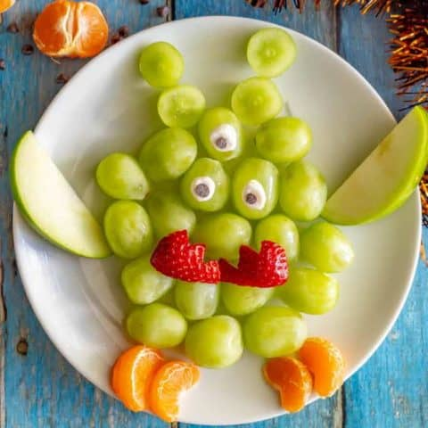 Easy green monster fruit snack plate with grapes, apples and oranges