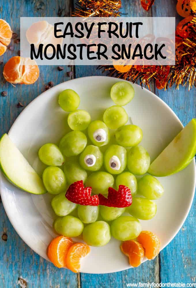 This easy green monster fruit snack plate is a cute, fun and healthy Halloween snack for kids! You can make these fruit monsters big or small and add as many arms, legs and eyes as you want! #Halloween #kidsnack #healthysnack #fruitsnack