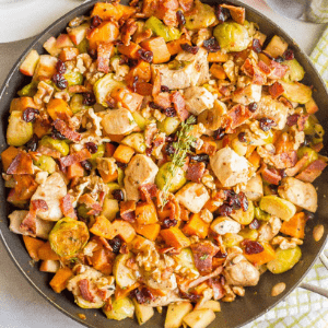 One-pot easy harvest chicken skillet with sweet potatoes and Brussels sprouts is a beautiful and delicious recipe that's perfect for a fall dinner!