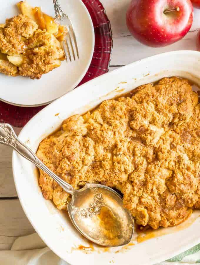 This healthy apple cobbler is full of apple and cinnamon flavors and goes perfect with ice cream for a delicious dessert. It's naturally sweetened and made with whole grains for a healthier sweet treat that will surely satisfy. #apples #cobbler #dessert #baking