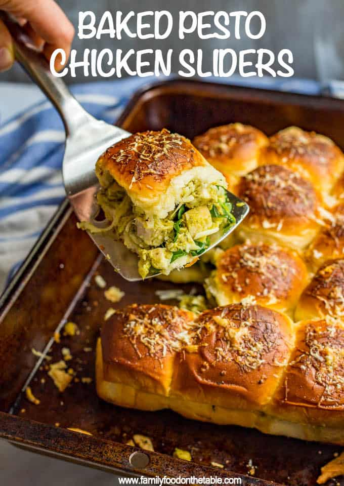 These easy baked pesto chicken sliders are just 5 main ingredients but full of flavor! They are great for a party or game day appetizer and always go fast! #pestochicken #chickensliders #sliders #appetizers #gamedayeats