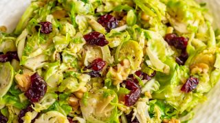 Shredded Brussels sprouts with cranberries and walnuts