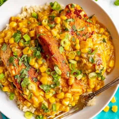 Skillet chicken with creamed corn is an easy weeknight dinner that's ready in just 25 minutes. Serve over rice or quinoa to soak up the delicious, creamy corn sauce! #corn #chickenrecipe #chickendinner #easyrecipe