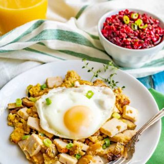 Thanksgiving leftovers breakfast hash is a warm, hearty delicious breakfast that uses leftover Thanksgiving turkey, dressing or stuffing, veggies and gravy, all topped with a fried egg! #Thanksgiving #Thanksgivingleftovers #breakfast #breakfasthash