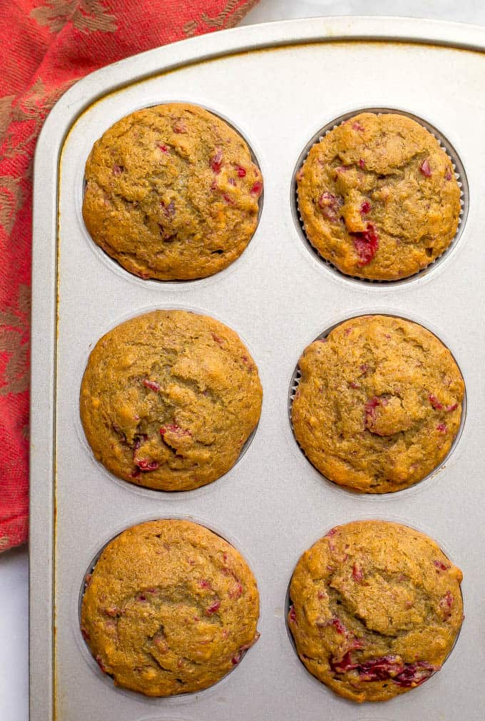 Whole wheat cranberry sauce muffins in a muffin tin after baking