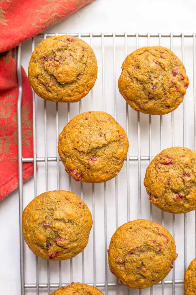 Whole wheat cranberry sauce muffins are a beautiful and fun way to use extra cranberry sauce! Top with a smear of butter and enjoy for a delicious, festive holiday breakfast! #cranberries #cranberrysauce #thanksgiving #holidays #muffins