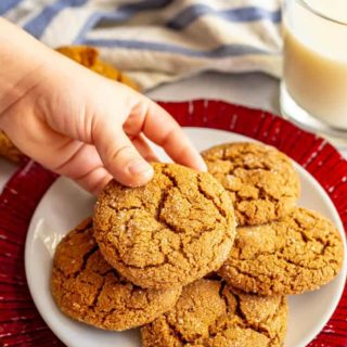 These old fashioned soft molasses cookies are full of warm spices and have a sugar coating on the outside. They smell just like the holidays and are great for cookie exchanges, bake sales, and sharing with friends and family! #molassescookies #cookies #cookieexchange #cookierecipe