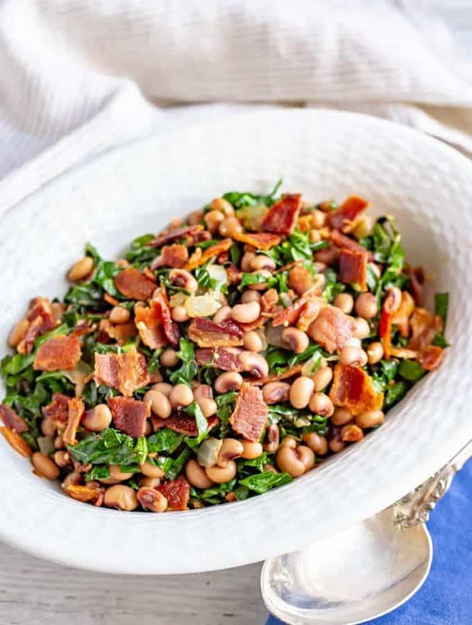 Collard greens and beans with bacon are a favorite Southern recipe, made quick and easy here with a few shortcuts. It's great for a New Year's Day meal or an anytime dinner side dish! #collards #beans #fieldpeas #sidedish #newyearsfood