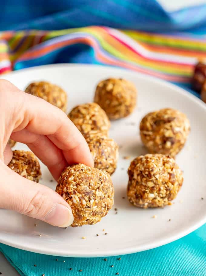 Healthy peanut butter energy balls are just 4 wholesome ingredients and so easy to make! They're great for a post-workout snack, afternoon snack or on-the-go energy boost! #energyballs #peanutbutter #healthysnack #glutenfreesnack #glutenfreerecipes