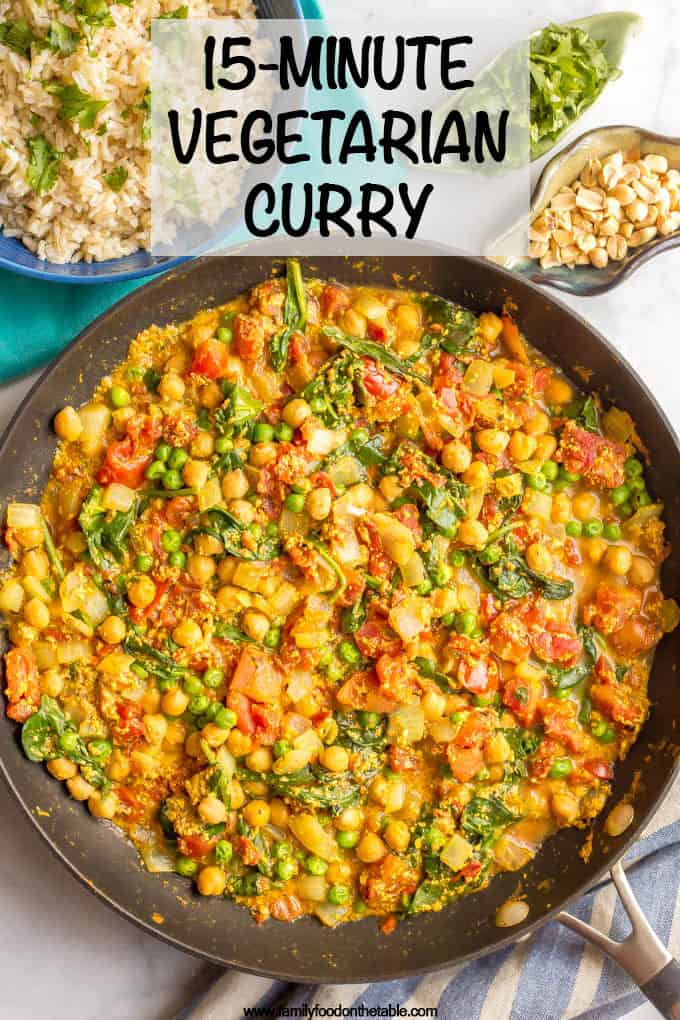 This quick and easy vegetarian curry is loaded with chickpeas, spinach, green peas and plenty of warm spices for a bright, beautiful and flavorful dinner! #curryrecipe #vegetariancurry #easyvegetarian #quickeasydinner