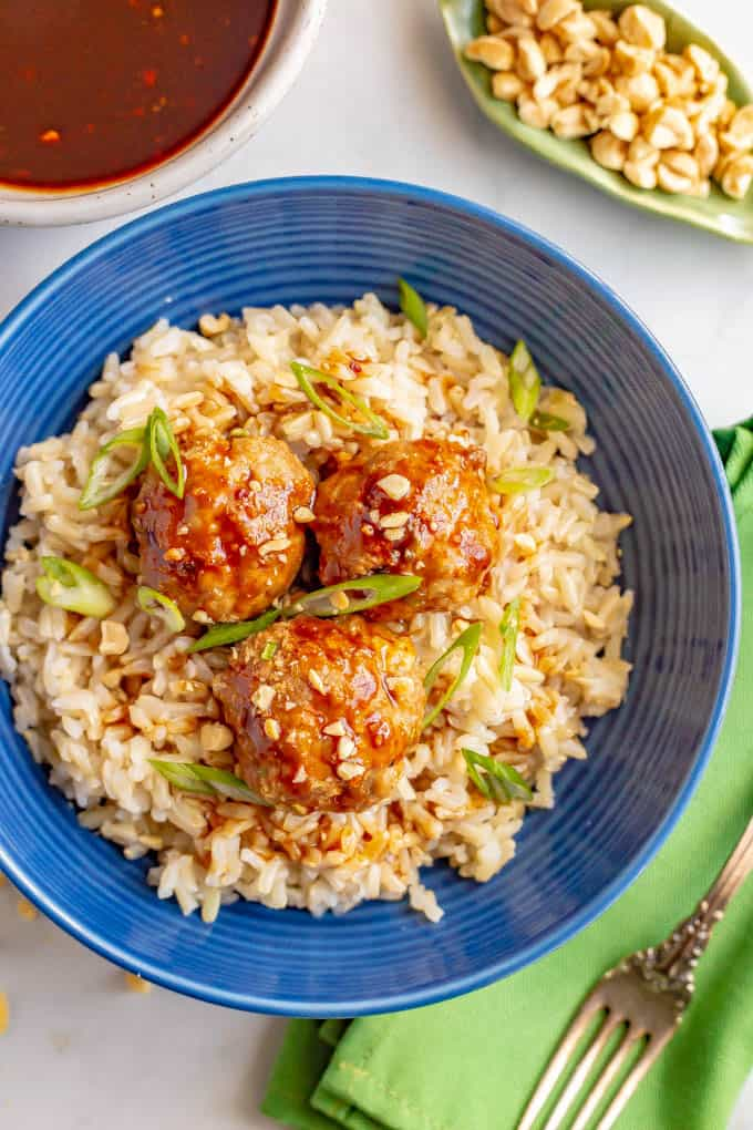 Baked Asian turkey meatballs with hoisin sauce and brown rice in a blue bowl