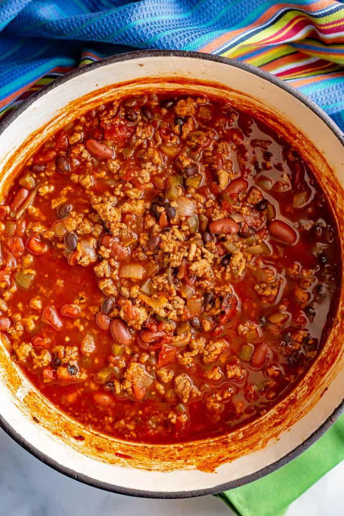 Large cooked pot of game day chili with meat and beans